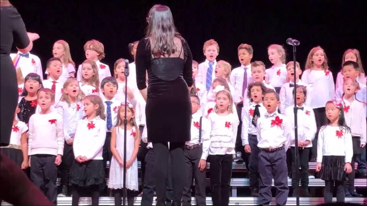 children singing in three rows